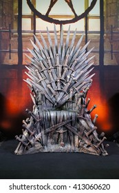 """BANGKOK - APR 29, 2016 : A Royal Throne in Medieval style made from swords front view, Photo Booth set up to promote """"Game of Thrones"""" new season. Game of Thrones is a famous American drama series."""