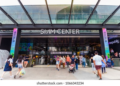 BANGKOK - APR 4: People walking in front of Siam Center Shopping mall on April 4, 2018. Siam Center Shopping Mall is one of the popular shopping center in Bangkok