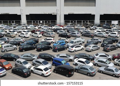 BANGKOK - APR 5: Cars parked at a park and side lot at a BTS station in Chatuchak district on Apr 5, 2013 in Bangkok, Thailand. The government has promoted park and ride to reduce traffic congestion.
