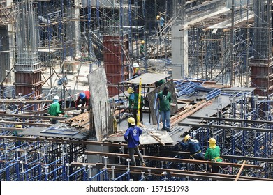 BANGKOK - APR 5: Construction workers at work on Siam Square One on Apr 5, 2013 in Bangkok, Thailand. The shopping mall is built on the former site of Siam Theatre, set ablaze during riots in 2010.