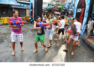 BANGKOK - APRIL 12: Revellers celebrate the Thai New Year near Khao San Road on April 12, 2013 in Bangkok, Thailand. The new year, or Songkran, is celebrated with street parties and water fights.