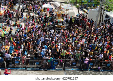 BANGKOK - APRIL 13: Unidentified people celebrate Songkran Day with water fights on April 13, 2017 at Siam Square in Bangkok. Pouring or spraying water to people on Songkran is a Thai tradition.