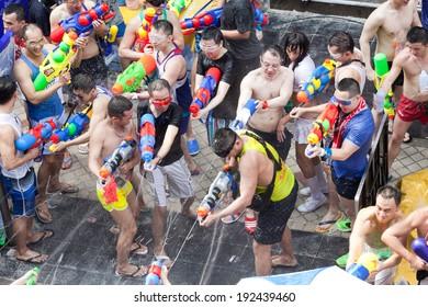 BANGKOK - APRIL 14,2014: BANGKOK - A water fight during Songkran Festival celebrations on Silom Road in Bangkok Thailand.