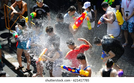 BANGKOK - APRIL 15: Unidentified people have a water fight on Songkran Day, April 15, 2017 on Silom Road in Bangkok. Water fights are a popular way to celebrate Songkran Day.
