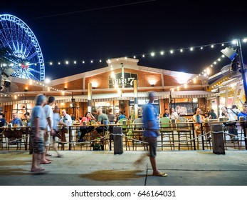 BANGKOK - APRIL 27 : People walking at Asiatique The Riverfront on April 27, 2017 in Bangkok, Thailand.Asiatique The Riverfront is a large open-air night market in Bangkok, Thailand.
