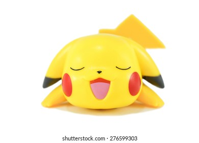 """BANGKOK - APRIL 5, 2015 : Photo of Pikachu figure, a famous Japanese cartoon character from Pokemon animation. Pikachu is an electric type Pokemon, introduced in genration 1, known as """"Mouse Pokemon""""."""