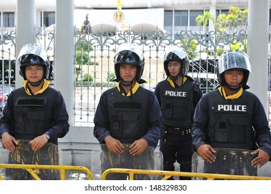 BANGKOK - AUG 1: Police on standby at Thai Parliament as the government invokes martial law amid threats to national security and planned anti-government rallies on Aug 1, 2013 in Bangkok, Thailand.