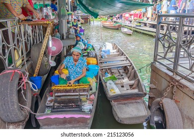 BANGKOK - AUG 2: Taling Chan Floating Market on Aug 2, 14 in Bangkok. The market sale food items, offered on rafts, and in paddle boats with the genuine atmosphere of the riverside.