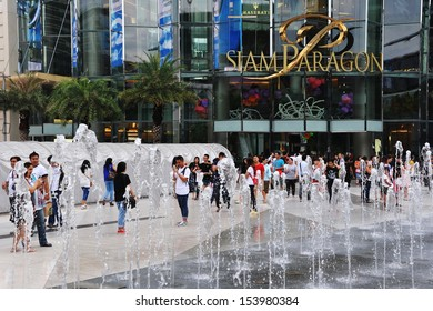 BANGKOK - AUG 25: Shoppers visit Siam Paragon mall in the Siam Square area on Aug 25, 2013 in Bangkok, Thailand. With 300,000 sq m of retail space Siam Paragon is one of the world's largest malls.