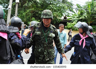 BANGKOK - AUG 7: Activist Capt Songklod Chuenchupol is arrested by police at an anti-amnesty bill rally near parliament on Aug 7, 2013 in Bangkok, Thailand.