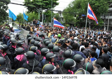 BANGKOK - AUG 7: Protesters confront police near parliament during an anti-amnesty rally on Aug 7, 2013 in Bangkok, Thailand. Over 30,000 police are deployed at government sites to counter protests.