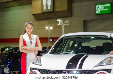 BANGKOK - AUGUST 1 : Unidentified model with Nissan car on display at Bangkok International Grand Motor Sale 2015 is exhibition of vehicles for sale on August 1, 2015 in Bangkok, Thailand.