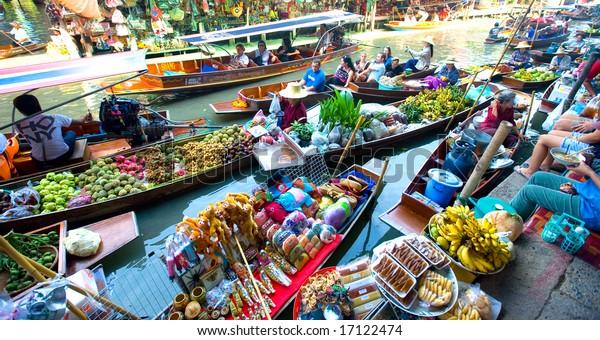 Bangkok August 2008. Busy sunday morning at Damnoen Saduak floating market, Bangkok Thailand of locals selling fresh produce, cooked food and souvenirs.