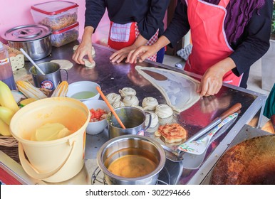 """BANGKOK - AUGUST,2 : Unidentified seller cook and prepare flour before fried in the pan that called """" ROTI """" .It is the dessert in Indian style .THAILAND AUGUST,2 2015"""