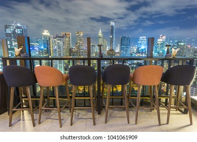 Bangkok building city skyline at sunset on top view with many chair