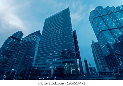 Bangkok business district city scape at night office building and hotel street view.