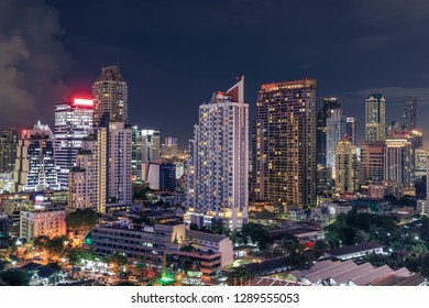 Bangkok business district cityscape with skyscraper at night, Th