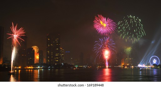 Bangkok, capital city of Thailand at night and firework in the middle of the river