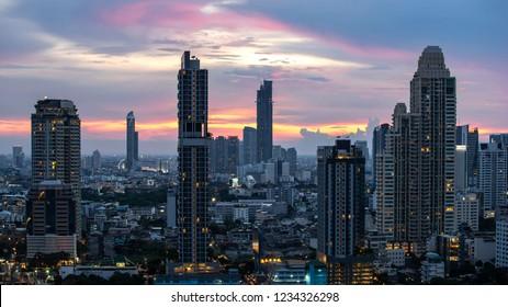Bangkok City - Aerial view  beautiful sunset  Bangkok city tower downtown skyline of Thailand , City scape at night  , landscape Bangkok Thailand