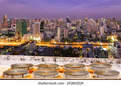 Bangkok city aerial view at twilight, business district with high building at twilight time.