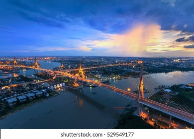 Bangkok City - Beautiful sunset view of Bhumibol Bridge in Bangkok , Bridge of transportation for import , export , Bangkok ,Thailand