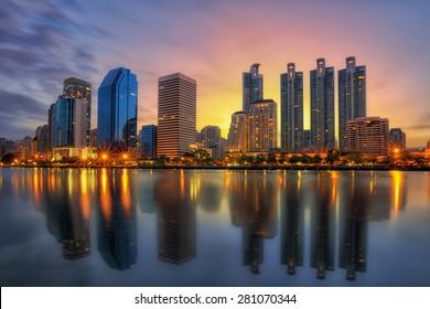 Bangkok city downtown at sunrise with reflection of skyline, Bangkok,Thailand