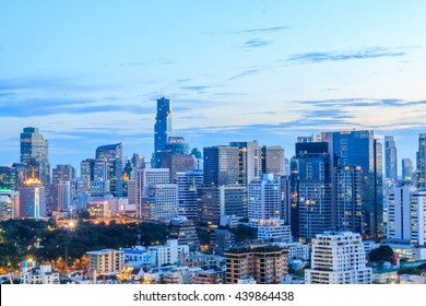 Bangkok city in the evening . Panoramic and perspective view light blue background of glass high rise building skyscraper commercial of future. Business concept of success industry tech architecture