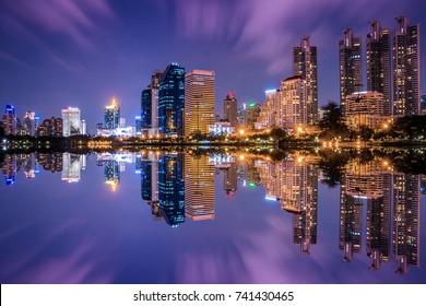 Bangkok city night light reflection on water
