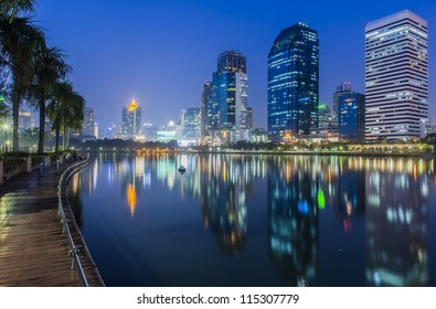 Bangkok city at night with reflection of skyline