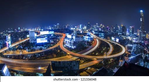 Bangkok city night view with main traffic high way.
