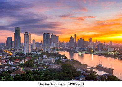Bangkok City and the river,Hotel and resident area in the capital of Thailand at beautiful sunrise.