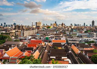 Bangkok city scape at sunset from the top of the phu khao thong or golden mountain of wat saket, or the golden mount temple. A landmark of bangkok city, Thailand.