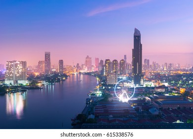 Bangkok city skyline with Chao Phraya river view during twilight.