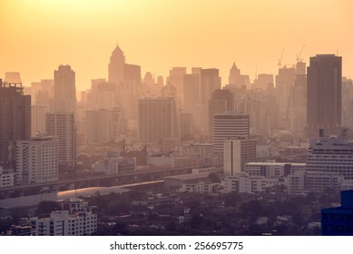 Bangkok City skyline with urban skyscrapers at sunset.