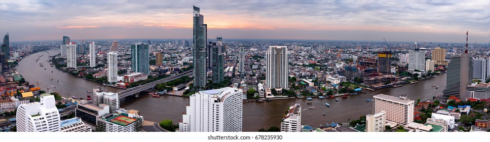 Bangkok  city sunset river  .Panoramic and perspective view light gold background of glass high rise building skyscraper commercial of future. Business concept of success industry tech architecture