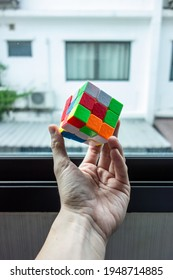 Bangkok City, Thailand – April 03, 2021: Rubik's Cube was invented in 1974 by Hungarian sculptor and professor of architecture Erno Rubik. Size 3 cube. Personal perspective. Selective focus.