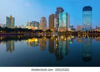 Bangkok Cityscape, Business district with Park in the City at dusk (Thailand)