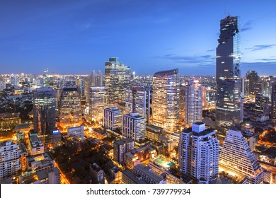 Bangkok Cityscape at dusk. Landscape of Bangkok business building at twilight. Thailand aerial view of modern high building with cloudy sky.