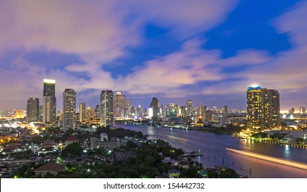 Bangkok cityscape Modern building river side on twilight time,Thailand