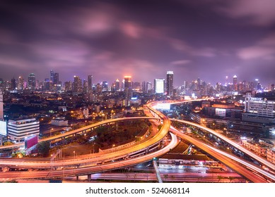 Bangkok cityscape night view with twilight sky, expressway and highway top view, Thailand