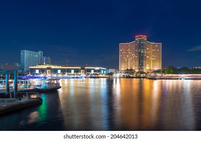 Bangkok cityscape river side with harbour at twilight time, Thailand