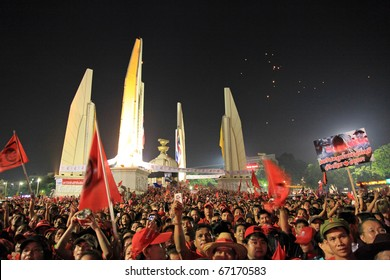 BANGKOK - DEC 10: Red Shirts - At least 10,000 anti-government protesters return to the streets of Bangkok's at Democracy Monument to make themselves heard on December 10, 2010 in Bangkok