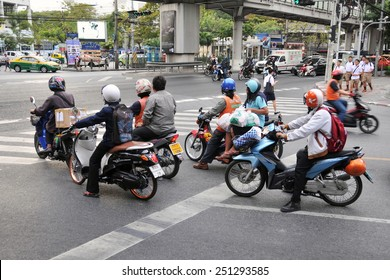 BANGKOK - DEC 17: Motorcyclists wait at a junction during rush hour on Dec 17, 2010 in Bangkok, Thailand. Motorcycles are often the transport of choice for Bangkok's heavily congested roads.