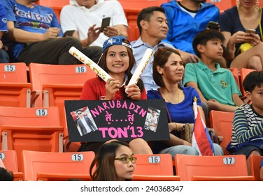 BANGKOK, DEC 17:Unidentified Thai fans cheer in action during the competition 2014 AFF Suzuki Cup between Thailand and Malaysia at Rajamangala stadium on December 17, 2014 in Bangkok, Thailand.