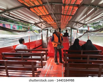 BANGKOK - DEC 2017: A conductor sells tickets at a water bus. The Khlong Saen Saep boat service is a water bus operating on the Saen Saep Canal in Bangkok through the traffic congested districts.