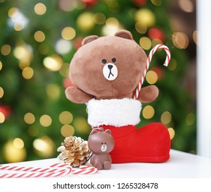 Bangkok - Dec 23, 2018 : A photo of Christmas Brown bear in the red Christmas boot holding candy cane. Brown is the name of line character. Line is a very popular chat application in Thailand & Japan.