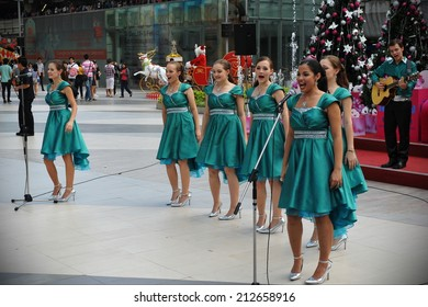 BANGKOK - DEC 23: Unidentified choir singers perform Christmas carols at Siam Paragon mall courtyard on Dec 23, 2011 in Bangkok, Thailand. Siam Paragon boasts 300,000 square metres of retail space.