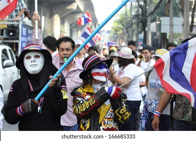 BANGKOK - DEC 9: Many Masked protesters walked for anti government corruption on December  09, 2013 in Bangkok, Thailand. The protesters required  Yingluck Shinawatra Prime Minister resign.