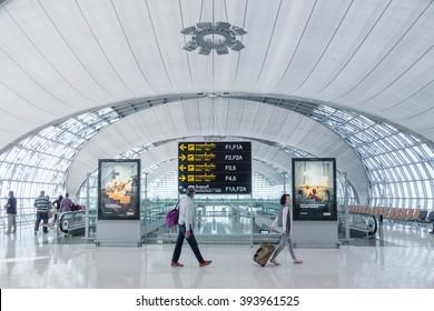 BANGKOK - DEC18: An unidentified travellers at Suvarnabhumi International Airport on December 18, 2015 in Bangkok, Thailand. The airport handles 45 million passengers annually