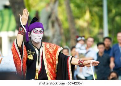 BANGKOK - DECEMBER 10: Happy Yoshizawa-ya, a Japanese father/daughter team, performs Kabuki Magic at Bangkok International Street Show in Lumpini Park on December 10, 2010 in Bangkok, Thailand.